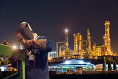 Industrial welding worker at the petrochemical plant Stock Photos