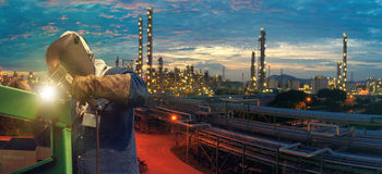 Industrial welding worker at the petrochemical plant Stock Photography