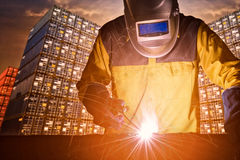 Industrial welding worker with safety equipments Stock Photography
