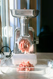 Industrial white Raw Meat Grinder. Industrial Meat Grinder on kitchen counter Stock Images