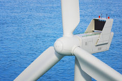 Industrial wind turbine close up in sea Stock Images