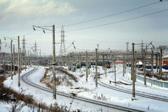 Industrial winter cityscape with railroads Royalty Free Stock Photos