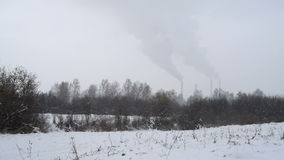 Industrial winter view with smoke. General plan of the factory. Winter snow industry stock video