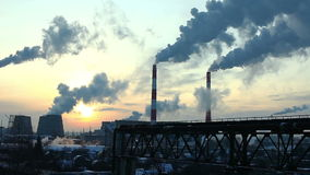 Industrial winter view at sunset with smoke Stock Photography