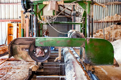 Industrial wood factory - bandsaw sawmill Stock Photos