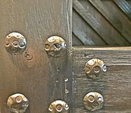 Industrial wood image with large bolts Royalty Free Stock Images