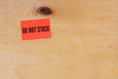 Industrial wooden background with label writing - do not stack Stock Photos