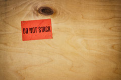 Industrial wooden background with label writing - do not stack Stock Photo