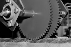 Industrial woodworking machine with circular saw disk. Toned image. Industrial woodworking machine with circular saw disk. Milling machine for wood. Black and royalty free stock photography
