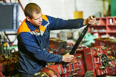 Industrial worker assembling the reduction gear box Royalty Free Stock Photo