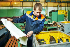 Industrial worker assembling the reduction gear box Stock Photo