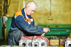 Industrial worker assembling the reduction gear box Stock Images