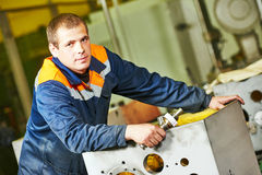 Industrial worker assembling the reduction gear box Stock Image
