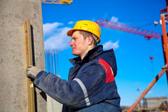 Industrial worker checking vertical level Stock Image