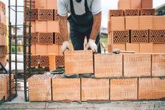 worker, construction worker using modern bricks for brickwork, building walls Stock Photos