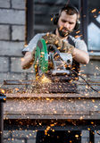 Industrial worker cutting metal Royalty Free Stock Image
