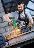 Industrial worker cutting metal Royalty Free Stock Photos