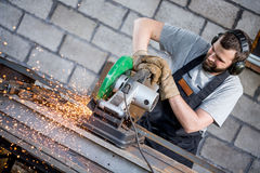 Industrial worker cutting metal Stock Image