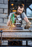 Industrial worker cutting metal Royalty Free Stock Photo