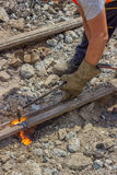 Industrial worker cutting a old tram tracks with an oxy-acetylen Royalty Free Stock Photography