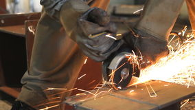 Industrial Worker cutting steel metal. Royalty Free Stock Photos