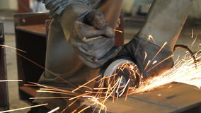 Industrial Worker cutting steel metal with grinder. Royalty Free Stock Images