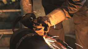 Industrial worker cutting steel. Royalty Free Stock Photos