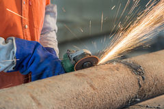 Industrial worker cutting and welding metal with many sharp spar Royalty Free Stock Images