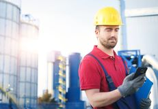 Industrial worker dressed in overalls outside a factory Stock Photography