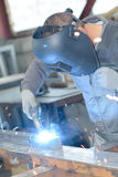 Industrial worker at factory welding Stock Image