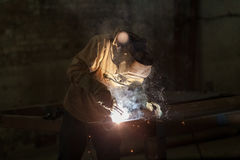 Industrial Worker at the factory welding closeup. Industrial Worker at the factory welding closeup Stock Images