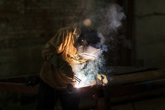 Industrial Worker at the factory welding closeup. Royalty Free Stock Photo