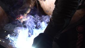 Welding iron sparks. Industrial Worker at the factory welding closeup
