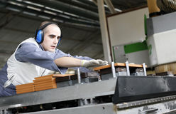 Industrial worker in furniture factory Stock Photos