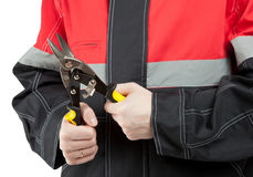 Industrial worker holding wire cutters Stock Images