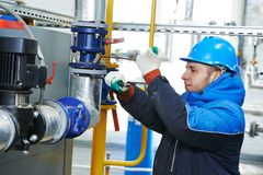 Industrial worker at installation work Stock Photos
