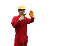 Industrial Worker - Isolated Over White Background. A portrait of a worker in red overalls and yellow helmet, with talkie-walkie Stock Image