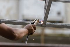 Industrial worker labourer welding steel structures. Industrial worker - male labourer welding steel structures Royalty Free Stock Images