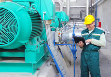 Industrial worker with notebook stock image