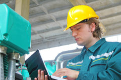 Industrial worker with notebook Royalty Free Stock Images