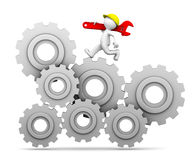 Industrial worker running up a gear mechanism Royalty Free Stock Photo