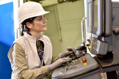 Industrial worker setting up a machine Royalty Free Stock Images