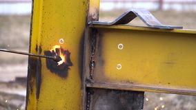Industrial worker in special gloves cut metal with cutting torch in yellow metal construction. Industrial worker in special gloves cut metal with cutting torch stock footage