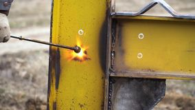 Industrial worker in special gloves cut metal with cutting torch in yellow metal construction. Industrial worker in special gloves cut metal with cutting torch stock video