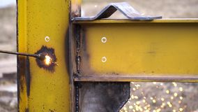 Industrial worker in special gloves cut metal with cutting torch in yellow metal construction. Industrial worker in special gloves cut metal with cutting torch stock video footage
