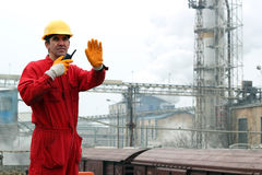 Industrial Worker in Sugar Refinery. A portrait of a worker in red overalls and yellow helmet Stock Image