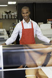 Industrial worker taking printouts Stock Photo