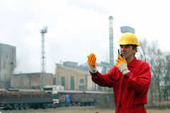 Industrial Worker Talking on Walkie-Talkie Royalty Free Stock Photography