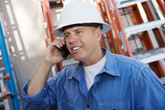 Industrial Worker Using Cell Phone. Male industrial worker using cell phone at workplace Stock Images