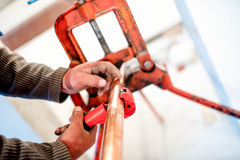 Industrial worker using industrial copper cutter in plumbing Stock Photo